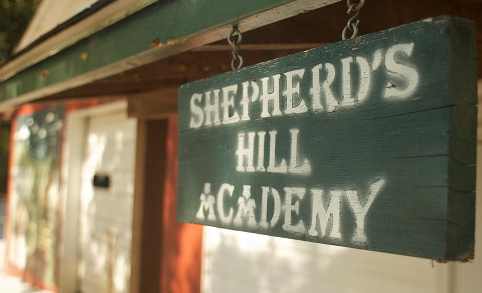 a sign that says Shepherds Hill Academy