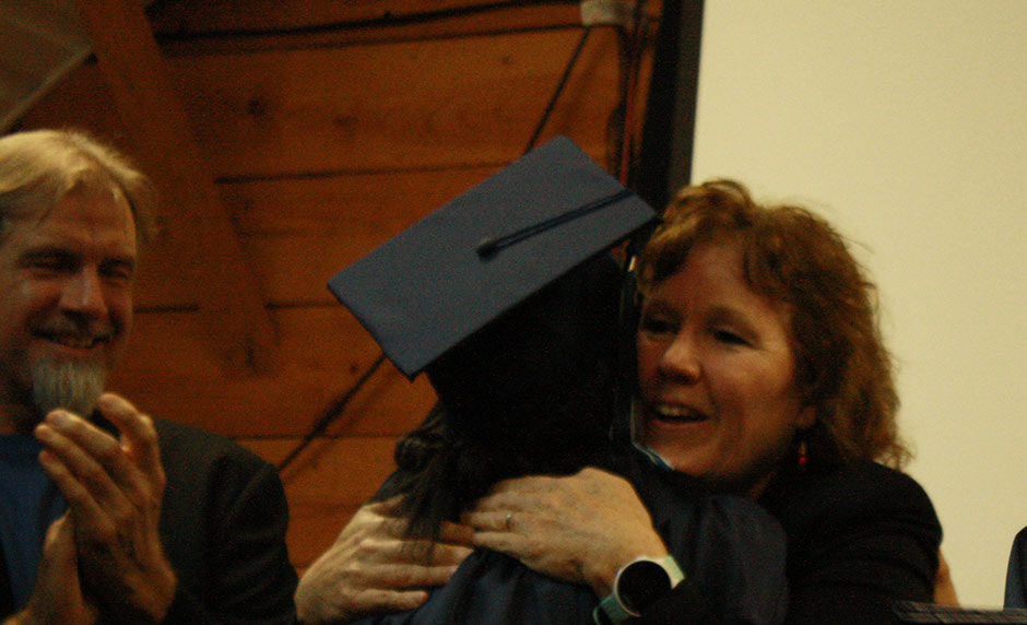 Graduating Student hugging co founder